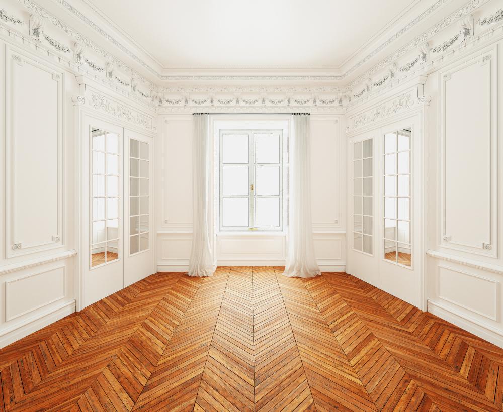 parquet point de hongrie dans une grande pièce blanche